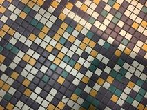 Colorful tile work in purple, white, gold, green Stock Photo