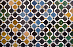 Colorful tiles, arabic style, in the Alhambra. Pattern or texture of ceramic tiles mosaic found in the Alhambra, in Granada, Spain Royalty Free Stock Images