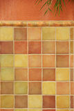 Colorful tiles on stucco wall. Colorful ceramic tiles on stucco wall for background and texture royalty free stock images