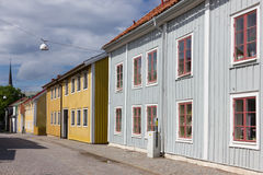 Colorful timber buildings. Vadstena. Sweden. Picturesque and colorful old two story buildings in Skänningegatan. Vadstena. Sweden Stock Images