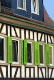 Colorful timber framed house stock photos