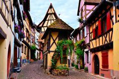 Colorful timbered houses of Alsace, France. Colorful timbered houses of the Alsatian town of Eguisheim, France Stock Image