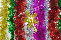 Colorful tinsel for christmas and new year decoration. The colorful tinsel for christmas and new year decoration, focused on star tinsel Stock Photos