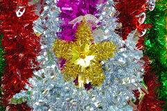 Colorful tinsel for christmas and new year decoration. The colorful tinsel for christmas and new year decoration, focused on star tinsel Stock Photo