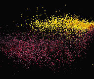 Colorful tiny particles over a dark background Stock Photography