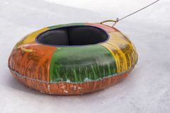 Colorful tires for sledding for kids stock photos