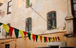 Colorful tissue flags and lamps decoration over street royalty free stock photos
