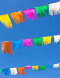 Colorful tissue Paper fringe garland under blue sky Stock Image