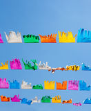 Colorful tissue Paper fringe garland under blue sky Royalty Free Stock Image