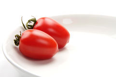 Colorful tomato. Beautiful and  delicious tomatoes in white porcelain plate Stock Images