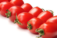Colorful tomato. Many delicious red tomatoes on the white background Royalty Free Stock Image