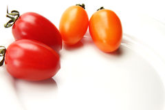 Colorful tomato. Beautiful and  delicious tomatoes in white porcelain plate Royalty Free Stock Images