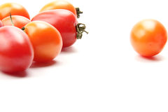 Colorful tomato. Many beautiful and delicious tomatoes on the white background Royalty Free Stock Photo