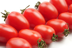 Colorful tomato. Many delicious red tomatoes on the white background Royalty Free Stock Images