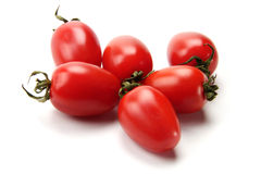 Colorful tomato. Many delidious red tomatoes on the white background Stock Photography