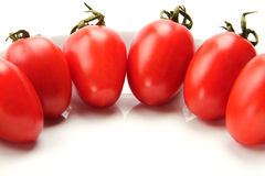 Colorful tomato. Many delidious red tomatoes on the white background Royalty Free Stock Photography