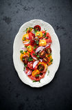 Colorful tomato salad with fresh parsley Royalty Free Stock Image
