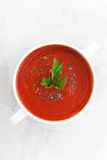 Colorful tomato soup on a white background, top view Royalty Free Stock Photo