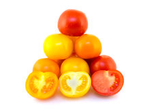 Colorful tomatoes. On white background Royalty Free Stock Photo