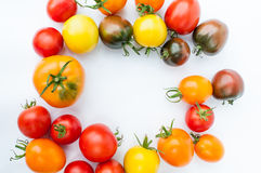 Colorful tomatoes. Fresh colorful tomatoes on a white background. Yellow, red, pink, orange and black tomatoes Stock Photo
