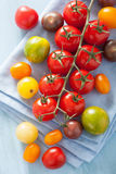 Colorful tomatoes over blue napkin Stock Photography