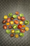 Colorful tomatoes on a plate Stock Images