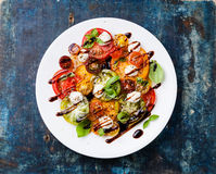Colorful tomatoes salad with mozarella Royalty Free Stock Images