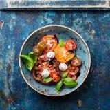 Colorful tomatoes salad Stock Photo
