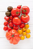 Colorful tomatoes. On a white wooden board Royalty Free Stock Photography