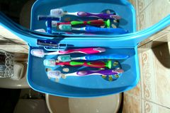 Colorful toothbrushes on a bathroom organizer with mirror Royalty Free Stock Photography