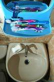 Colorful toothbrushes on a bathroom organizer with mirror Stock Images