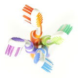 Colorful toothbrushes Stock Photos
