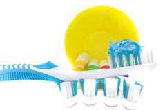 Colorful toothbrushes in cup with dental floss Stock Images