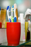 Colorful toothbrushes in a glass Royalty Free Stock Photos