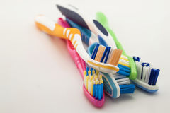 Colorful toothbrushes on white background with copy space. Macro Royalty Free Stock Photography