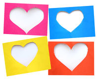Colorful torn paper in heart shape symbol over white background Stock Photos