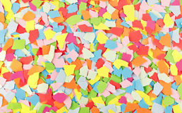 Colorful torn paper scraps. Background image of colorful torn paper scraps stock photo