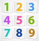 Colorful torn papers numbers Stock Photography