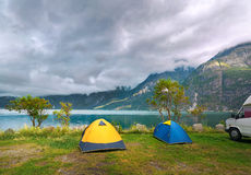 Colorful tourist tents on the shore of the lake. Norway Stock Photo
