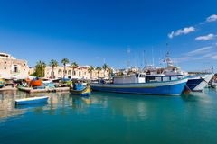 Port in Marsaxlokk on Malta. Colorful touristic landscape of Port in Marsaxlokk on Malta island. Beautiful seascape in south Europe Royalty Free Stock Photo