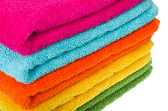 Colorful towel. Stacked colorful towels on a white backgroun Stock Images