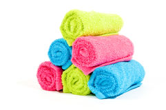 Colorful towel rolls on white. Colorful towel rolls on a white background stock photo