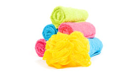 Colorful towel rolls with yellow bath sponge Stock Photography