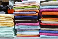 Colorful towel stacked rows in market Stock Image
