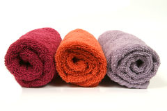 Colorful towels. Three colorful towel rolls on white background Royalty Free Stock Images