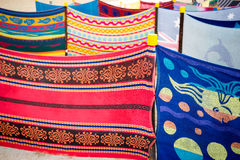 Colorful towels art display. Colorful towels of different design hung together in a beach Royalty Free Stock Image