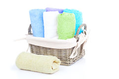 Colorful towels in basket Royalty Free Stock Images