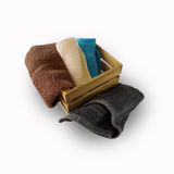 Colorful towels in basket isolated on white Royalty Free Stock Photo