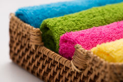 Colorful towels in a basket Stock Images