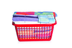 Colorful towels in basket Stock Photos